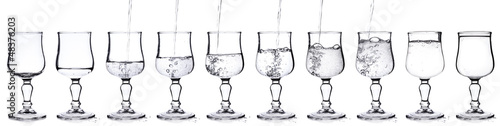 Fresh water pouring in a glass in sequence on white background