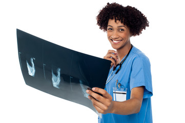Attractive young medical professional holding x-ray sheet