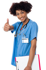 Happy lady doctor showing thumbs up sign