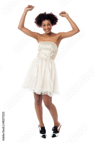Delighted young lady partying and dancing