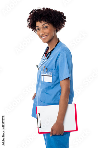 Smiling medical professional holding blank clipboard