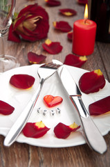 setting table for valentine's day with petals