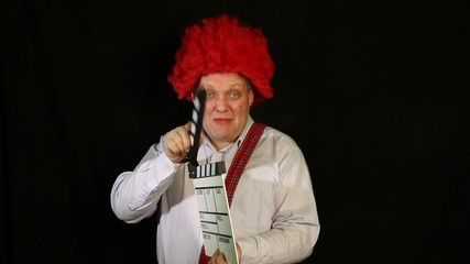 Clown with a movie clapperboard