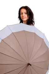 Positive young woman behind an umbrella