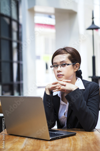 Confident businesswoman and laptop