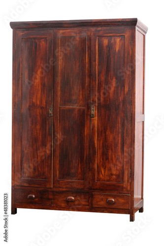 Old hancrafted cupboard isolated over white background