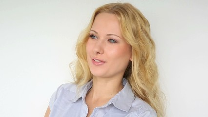 Beautiful blond woman on white background talking to camera