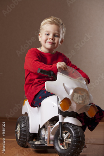 Happy Boy on Toy Motorcycle