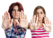 Latin women signaling to stop with their hands
