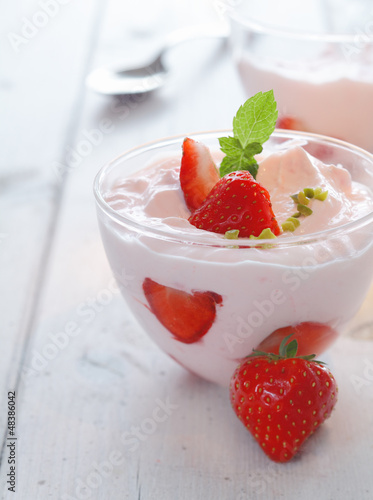 Deicious bowl of strawberries and cream