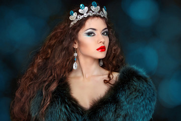 Beautiful woman with long hair in fur coat. Jewelry and Beauty.