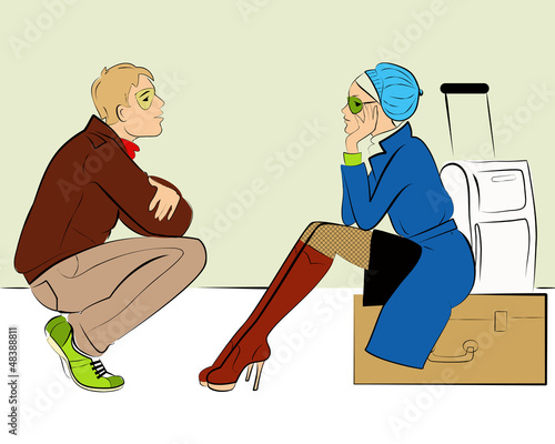 Couple sitting on the luggage waiting for a flight