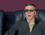 Senior man watching movie with 3d glasses