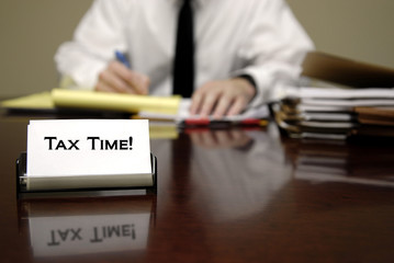 Tax Time Man at Desk