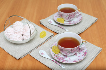 Romantic tea served in beautiful cups with marshmallow