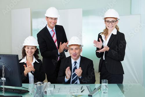 Cheering architectural team