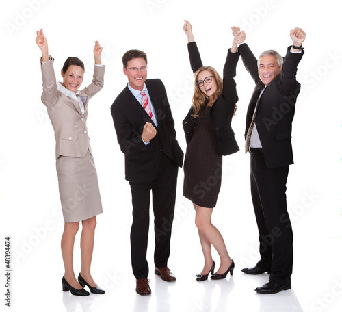 Four businesspeople celebrating