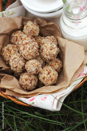 Cottage cheese cakes with almonds in a picnic basket