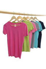row of colorful shirt rack on wooden hangers