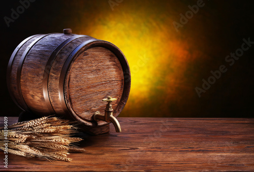 Old oak barrel on a wooden table.