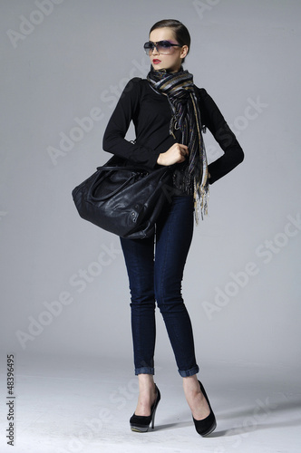 pretty woman with slim pose on gray background