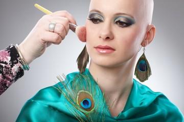Bald woman getting makeup