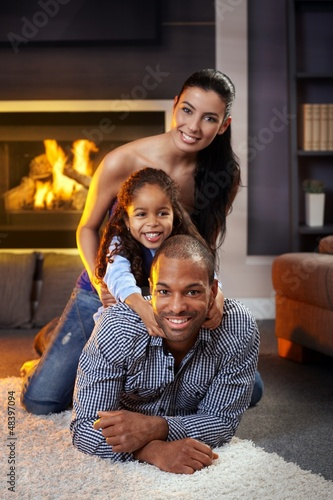 Portrait of happy family of three