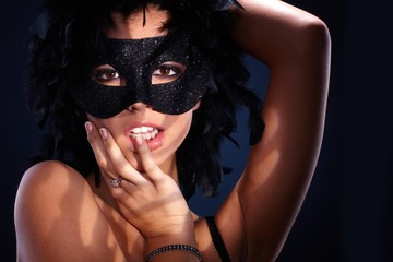 Seductive portrait of woman in masquerade