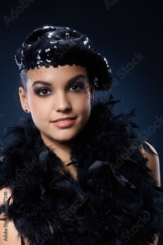 Party girl in black sequin hat and boa