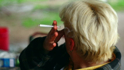 35mm camera - senior woman smoking close-up