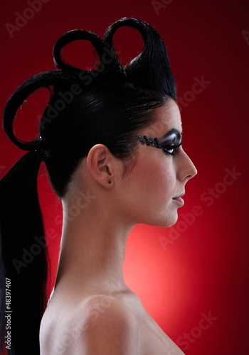 Woman with extravagant makeup and hairstyle