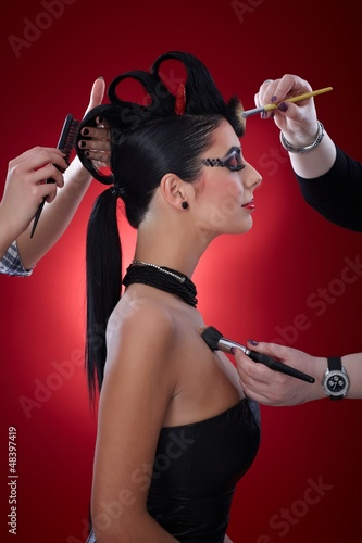 Makeup artists working on devil woman