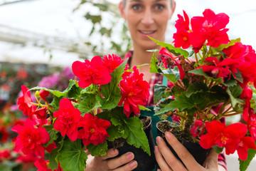 gardener in her green house flower shop