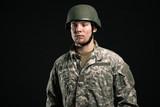 Military young man wearing helmet. Studio portrait.