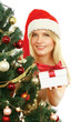 Beautiful girl in santa hat with gift christmas decorated
