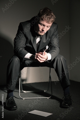 Suicidal business man in empty office.