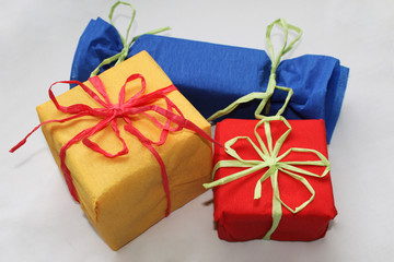 Three colorful presents on white background