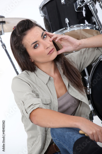 Woman about to play drums