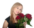 Young woman holding a bunch of red roses on white background