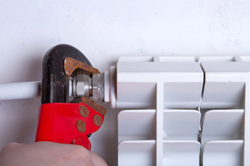 Plumber radiator repairs using hand tools