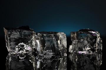 Ice cubes on dark blue background