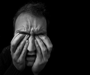 man feeling upset / in pain