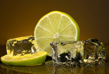 Ice cubes with lime on darck orange background