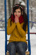 Cute girl on playground in winter