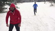 Man warming up, man jogging in winter, slow motion