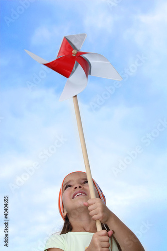 Little girl playing with windmill toy