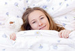 Young cute girl resting on the bed
