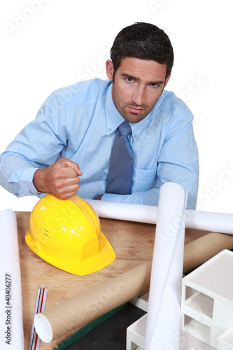 Architect with his fist on a hard hat