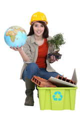 craftswoman posing with recycling tub