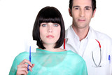 Hospital doctor and nurse holding a sterile gauze poster